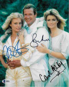 Roger Moore (1927-2017) / Carol Ashby / Mary Stavin James Bond 007 8X10 w//Beckett COA